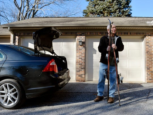 Former Pennsylvania state representative Ron Miller shows his skis outside his home in Jacobus shortly before leaving for Roundtop Mountain Resort.