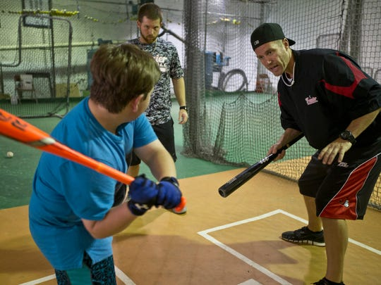 Jeff Frazier works out with Joshua Sommers, 9, of Bayville, with coach Brandon Bloodgood in background. The Frazier brothers, who run Frazier Baseball,  are putting on a junior baseball World Series which ends in Toms River late July.