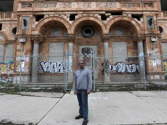 Craig Sasser, 63, of Detroit in front of the Lee Plaza Building, on West Grand Blvd. in Detroit, Sasser hopes to restore and develop the abandoned and striped building into market rate apartments  Friday, April 29, 2016.