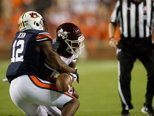 Auburn corner Jamel Dean (12) breaks up a pass intended for Mississippi State wide receiver Reginald Todd (20) on Saturday, Sept. 30, 2017 in Auburn, Ala.