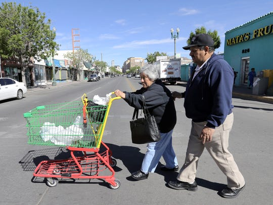 "Margarita Garza and her husband, Ricardo Garza, walk to the bus depot with their groceries after a shopping trip at Mata's Fruit Store in South El Paso. ""I live happy and in peace. I feel safe in my community,"" said Margarita, who has lived in El Paso for about 20 years."