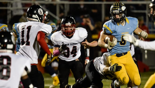 River Valley's Tyler Spears tries to break a tackle against Marion Harding last season.