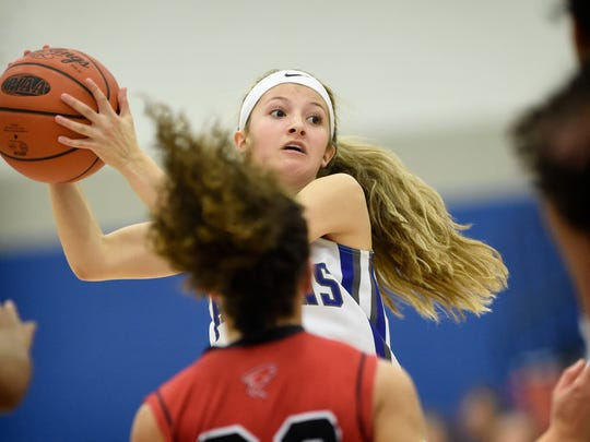 Cedar Crest's Jade Rolon looks to pass to an open teammate during the Falcons' win over McCaskey Thursday night.
