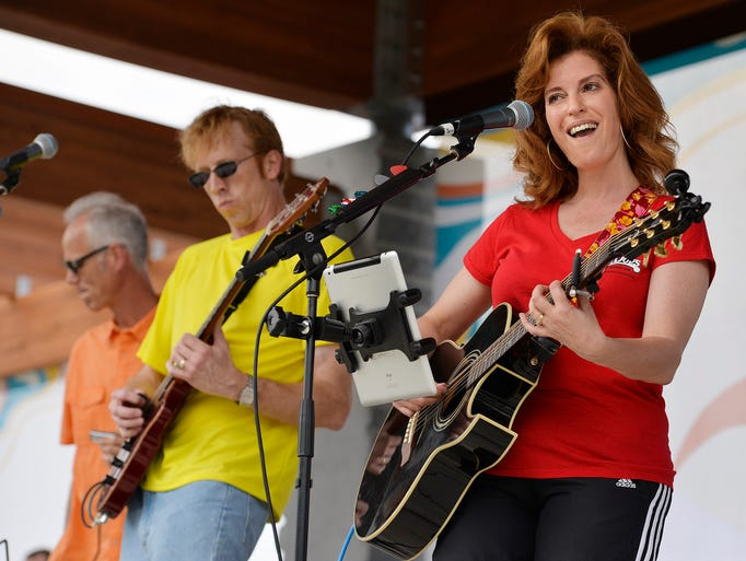 "Stearns County Attorney Janelle Kendall (right) belts out a version of the Eagle's ""Life in the Fast Lane"" with the band Walter's Wheelhouse to warm up the crowd Wednesday night, June 11 during the inaugural Summertime by George! event of the year."
