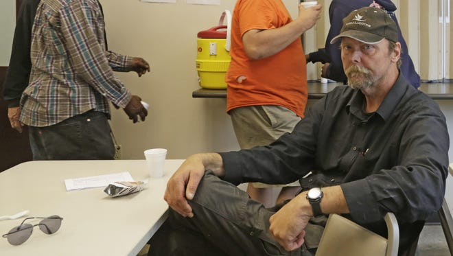 Kevin Ingram works three jobs to try to save enough money for housing. Ingram was a regular client at the Mental Health America homeless day shelter until it closed Sunday. On Tuesday, he spent the afternoon at the Lafayette Transitional Housing Center.