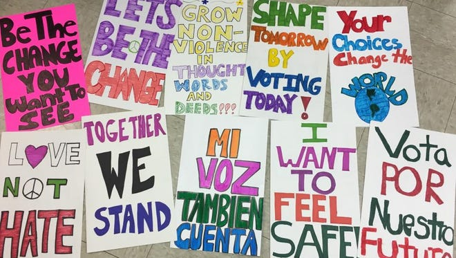 Signs show some of the messages to be sent by Salinas youth at Saturday's march and rally.