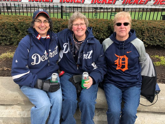 Baseball fans Darlene Sherbenou, left, and Gina Johnson of Ypsilanti have been going to Tigers Opening Day games together since 1999. Here they are last year enjoying round two with Joyce Chihan of Garden City.