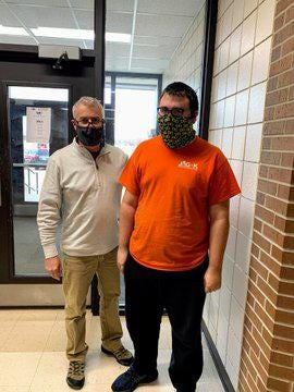 Hays High School Career Specialist Johnny Matlock (left) with HHS student Jonathan Rupe.