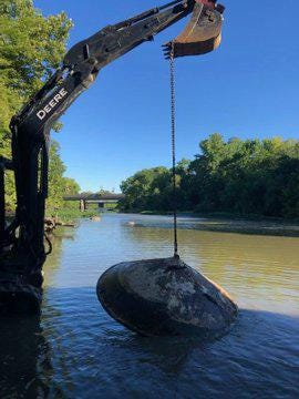 A backhoe and chain were used to hoist this mysterious hulk from the Olentangy River in Delaware Aug. 22 during a river cleanup day.