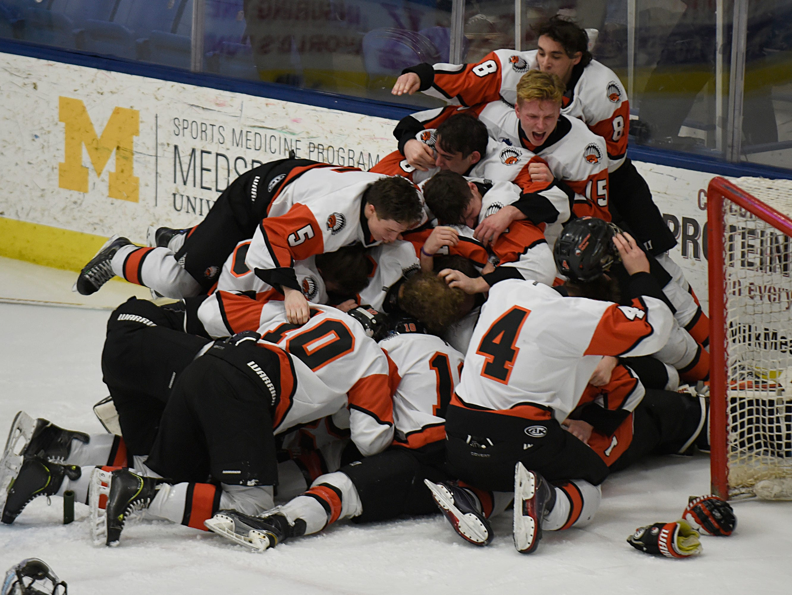 Brother Rice players celebrate after capturing the fifth state championship in program history on Saturday.
