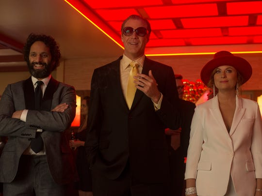 "Jason Mantzoukas (from left), Will Ferrell and Amy Poehler set up an underground casino to help pay for college in ""The House."""