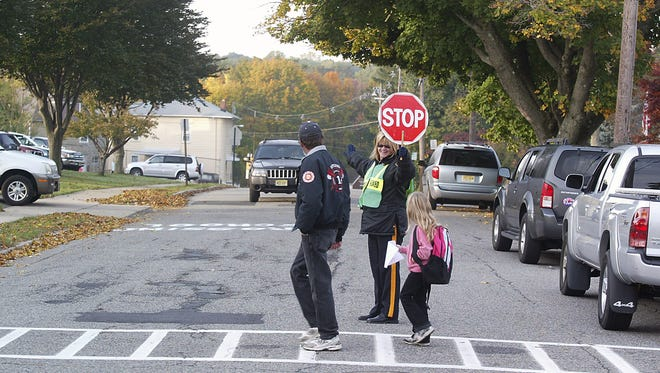 A student is escorted by a crossing guard on her way to  Netcong Elementary School in this 2010 file photo