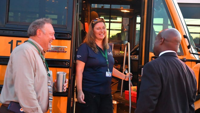 Arby Creech, director of tranportation, introduces Dr. Desmond Blackburn to Jenni Jinright, the bus driver he will be ridiing with on the first day of school.