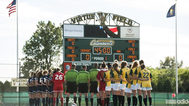 Both teams line up to listen to the National Anthem before the start of the women's soccer game between the New Hampshire Wildcats and the Vermont Catamounts at Virtue Field on Thursday afternoon.