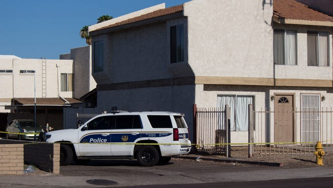 Phoenix police are investigating a fatal officer-involved shooting that occurred at a Phoenix apartment complex Aug. 13, 2016. Police say the officer killed a homicide suspect who cut him with a knife.