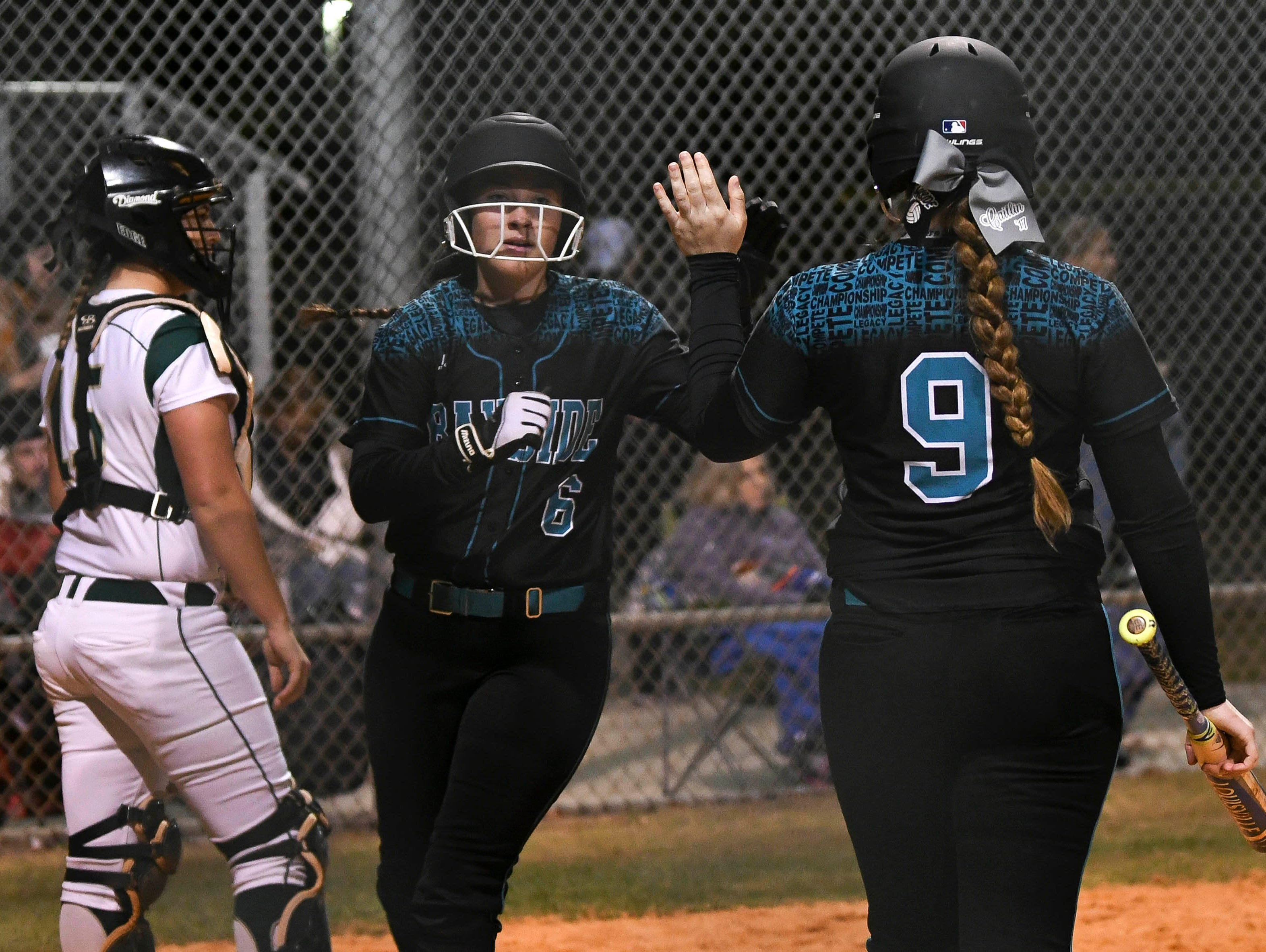 Bayside's Darby Miskow (6) is high fived by teammate Caitlin Meyer after she scores in Tuesday's game against Viera.