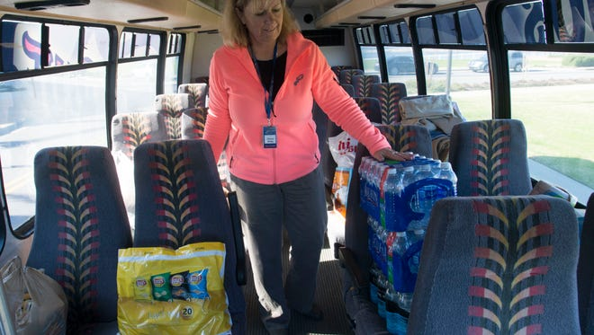 Donna Kirby, Blue Wahoos director of guest services and community relations, looks over some of the early donations the organization has collected in support of the recovery efforts for local victims of the recent storms. The Wahoos and the United Way of Escambia County are working together on the relief effort.
