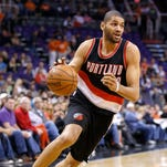 Portland Trail Blazers' Nicolas Batum, of France, dribbles the ball against the Phoenix Suns during an NBA basketball game, in Phoenix. The Charlotte Hornets acquired Batum from the Trail Blazers on Wednesday night, June 24, 2015, in exchange for guard Gerald Henderson and power forward Noah Vonleh.