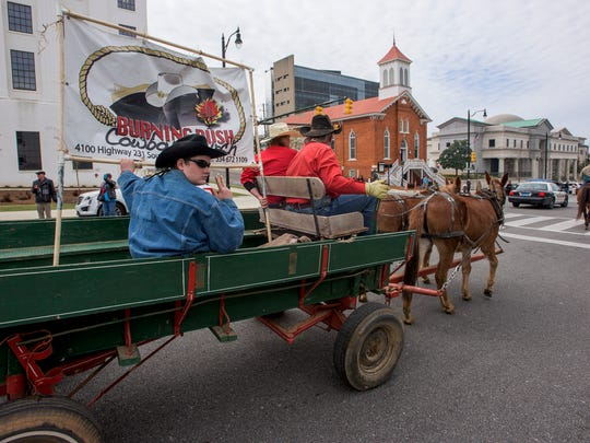 The SLE Rodeo Parade makes its way down Dexter Ave. in downtown Montgomery, Ala., on Thursday March 16, 2017. The SLE Rodeo will be held from Thursday the 16th to Saturday the 18th.