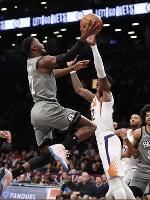 Nets guard Caris LeVert (22) goes up for two points with Phoenix Suns center Deandre Ayton (22) defending during the first quarter of 119-97 win. LeVert tied his career high with 29 points.