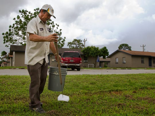 Maintenance worker Carmelo Calderon, picks up debris around the grounds of Farm Worker Village in Immokalee Monday afternoon. The Collier County Housing Authority is able to use about half of their units at Farm Worker Village for a general affordable housing supply that the county needs.