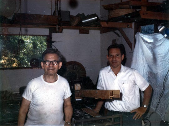 From left, Meyer 'Mickey' Thompson and son Daniel Thompson stand next to a bagel maker machine Mickey built in his garage workshop.