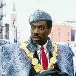 "Prince Akeem (Eddie Murphy, left) and his valet (Arsenio Hall) are mystified by the ways of New York City in 1988's ""Coming to America."""