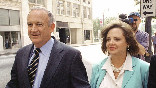 In this Aug. 28, 2000 file photo, John and Patsy Ramsey leave their attorney Lin Wood's offices.