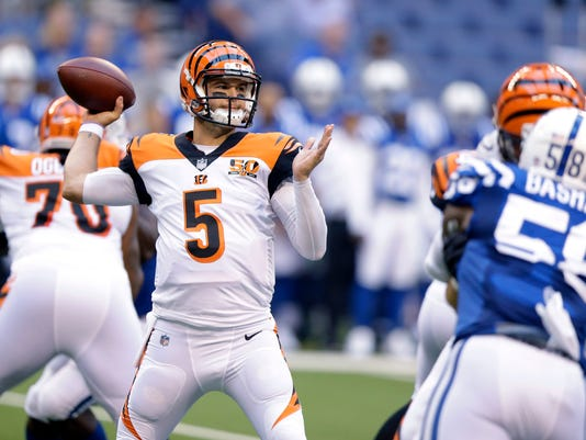 FILE - In this Aug. 31, 2017, file photo, Cincinnati Bengals quarterback AJ McCarron (5) throws during the first half of an NFL preseason football game against the Indianapolis Colts in Indianapolis. The Buffalo Bills took the first step in restocking their quarterback position by agreeing to a two-year contract Wednesday, March 14, with McCarron. The 27-year-old spent the past four seasons backing up Andy Dalton in Cincinnati after being selected by the Bengals in the fifth-round of the 2014 draft. (AP Photo/Michael Conroy, File)