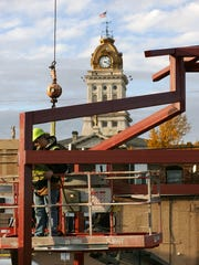 Construction workers make progress Monday afternoon on the Canal Market District farmer's market in downtown Newark.