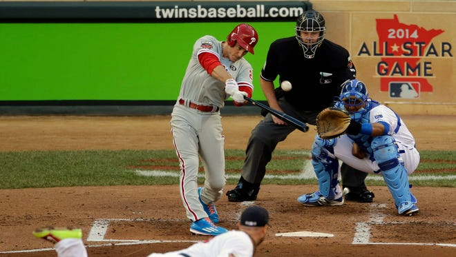 Phillies second baseman Chase Utley hits an RBI double for the National League during the second inning of baseball's All-Star game in Minneapolis on Tuesday.