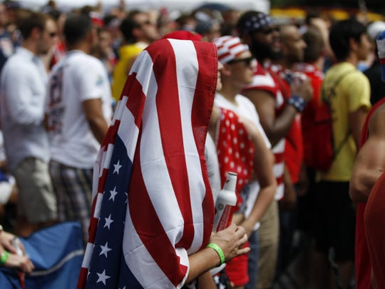 The American flag provided respite from the heat during a World Cup watch party held on Fountain Square in downtown Cincinnati Tuesday.