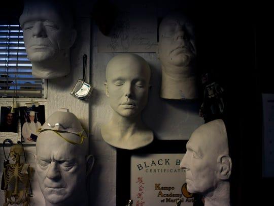 Various life casts, including Glenn Strange (clockwise, from top left), Boris Karloff, Lon Chaney, Peter Cushing and Natalie Portman, are on display in Daniel Horne's home studio.