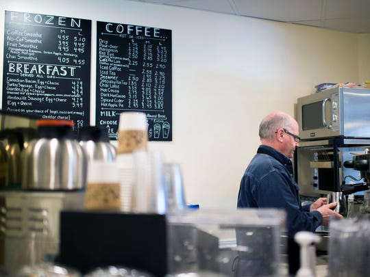 On What Grounds? coffee house owner Dana L. Gottloeb works behind the counter Friday, Feb. 20 in downtown Berlin.