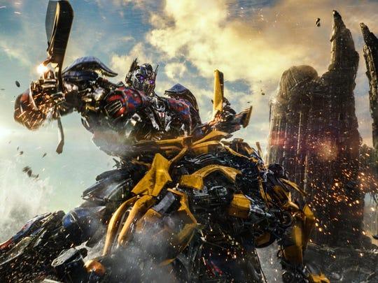 Optimus Prime (voice of Peter Cullen) battles Bumblebee