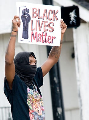 Dee Dee Backie of The Ohio Community Coalition takes part in a Black Lives Matter protest Thursday in front of Alliance Police Department.