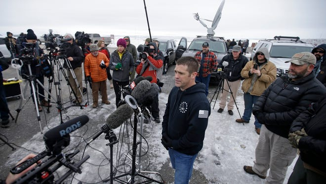 """Brandon Curtiss of the """"3% of Idaho"""" group speaks to the media after arriving at the Malheur National Wildlife Refuge, Saturday, Jan. 9, 2016, near Burns, Ore. A small, armed group has been occupying a remote national wildlife refuge in Oregon for a week to protest federal land use policies."""