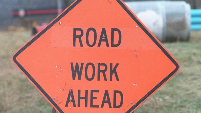 A construction sign for road work.