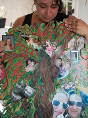 Bonnie Smith shows a memory collage she made in memory