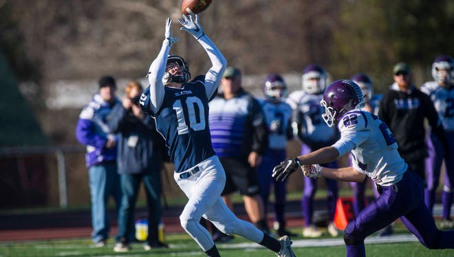 Fair Haven's Tim Fyles snags a pass in front of Bellows Falls' Shane Clark in the Division 2 high school football state championship in Rutland on Saturday, November 11, 2017.