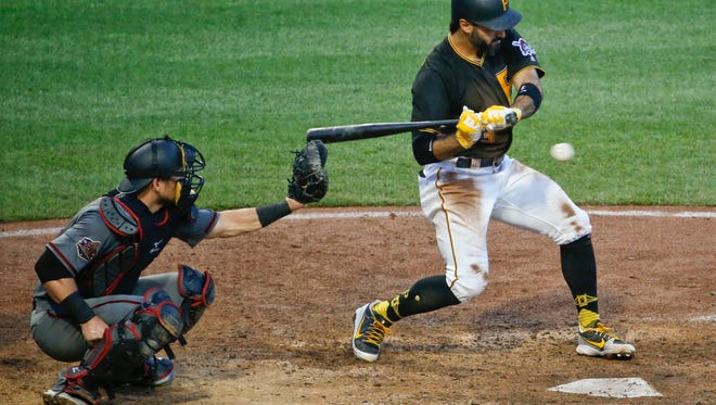 Pittsburgh Pirates' Sean Rodriguez, right, strikes out looking for the final out in the ninth inning of a baseball game as Arizona Diamondbacks catcher Jeff Mathis awaits the pitch, Saturday, June 23, 2018, in Pittsburgh.