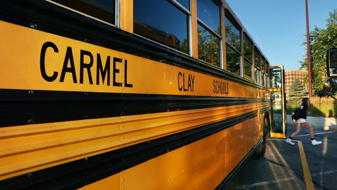 A Creekside Middle School student gets off a bus on the first day of school, Wednesday, August 13, 2014, as Carmel Clay Schools begin the 2014-2015 school year. The school, at 3525 W. 26th St., Carmel, has 1,600 students in grades 6-8.