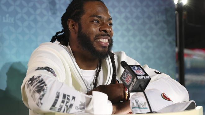 San Francisco 49ers cornerback Richard Sherman speaks to the media during Opening Night for Super Bowl LIV.