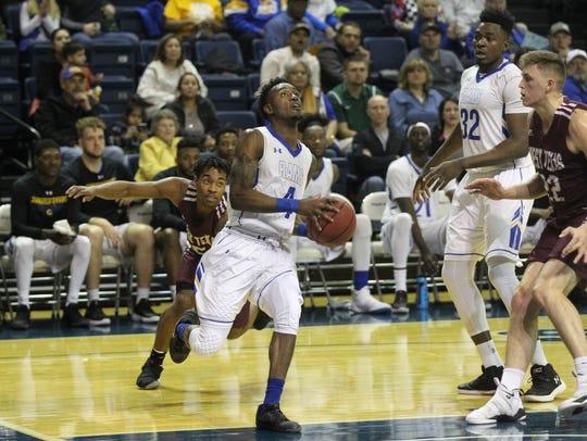 Angelo State University's Daron Mims (4) scored 12
