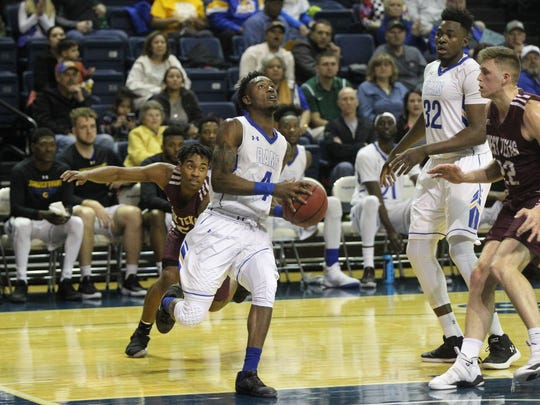 Angelo State University's Daron Mims (4) scored 12 points against West Texas A&M in a Lone Star Conference men's basketball game at the Junell Center on Thursday, Jan. 11, 2018.