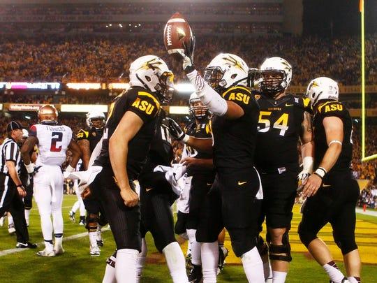 ASU running back D.J. Foster celebrates his touchdown