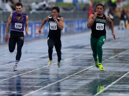 Isaiah Trousil of West Burlington Notre Dame, right, wins the boy's 100-meter dash final at the Drake Relays on Friday, April 28, 2017, in Des Moines.