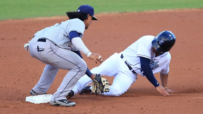 Hooks left-fielder Jason Martin is called out at second as he tries to steal and San Antonio Missions' Noah Perio gets the tag on Monday, June 19, 2017 at Whataburger Field.