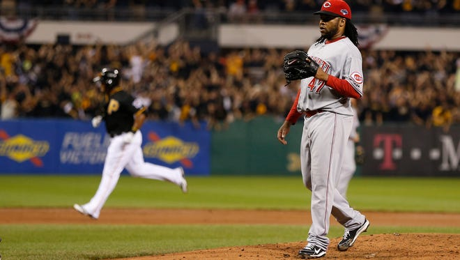 Reds starting pitcher Johnny Cueto reacts after giving up a home run to Pirates right fielder Marlon Byrd in the second inning during their Wild Card playoff game at PNC Park in Pittsburgh on Oct. 1.