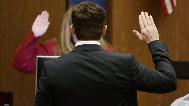 """Former Mesa police Officer Philip """"Mitch"""" Brailsford (front) takes the stand during his second-degree murder trial onWednesday, Nov. 29, 2017 at Maricopa County Superior Court in Phoenix, Ariz."""